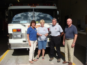 Linda and Ray Mury accepting Rotary Donation
